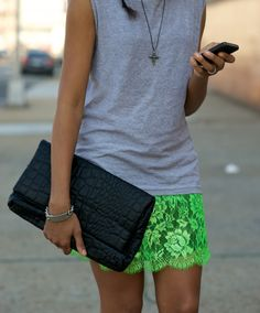 casual t-shirt, neon green skirt and black clutch...love it all together.