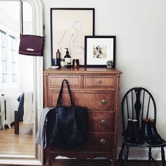pinterest | abbyycatherine Classy dark brown dresser in light modern apartment, take over mom's when they move out?