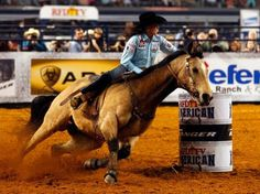 Lisa Lockhart (and Louie!) was the winner of the barrel racing event at The RFD-TV American rodeo at AT&T Stadium Sunday, March 1, 2015.
