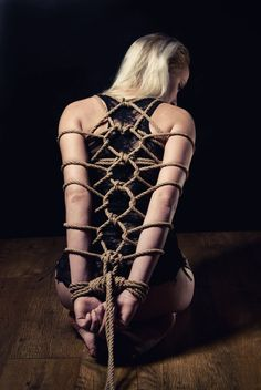 by Tomasz Górny - interesting knot to tie a models arms on her back. looks really nice. #bondage #shibari #fineart