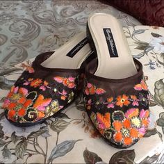 """NWOT Vintage Beverly Feldman slides These are absolutely MINT condition Beverly Feldman NEW OLD STOCK from the 80's! These have never been worn except to try on and are in perfect condition. From the Frankie & Baby """"too much is not enough"""" era. These are embroidered with vivid multi-colored flowers and gold threading on a very dark brown mesh. Beverly Feldman creates fabulous shoes! Sorry though, I don't have the box. Beverly Feldman Shoes"""