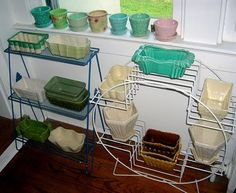 neat collection of vintage planters, love the old wire stands.