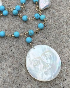 Braded turquoise with oearl necklace. Mother if pearl carved pendant