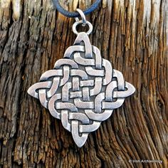 This Celtic knot pendant is based on Early Irish artwork.  It's complex interlace design is inspired by the decorative motifs used in early illuminated manuscripts, such as the 7th century Book of Durrow.