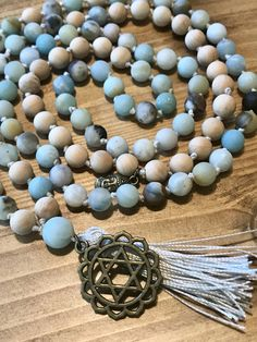 Excited to share the latest addition to my #etsy shop: The Uttanasana Mala- Inward Clarification and Healing. Matte Amazonite and Wood Japa Mala Necklace. 108, Hand Knotted http://etsy.me/2ihUnQX #jewelry #moksayoga