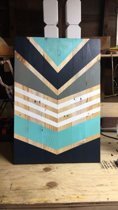 Pallet boards project. Chevron design. Grey, white, navy blue and Tiffany blue.