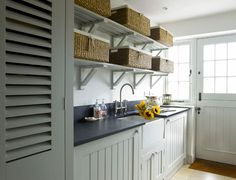 Slatted shelves on gallows brackets in the scullery for ironing baskets etc. From £15 per linear metre