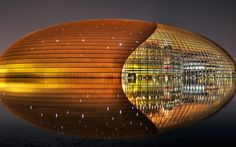 This is the National Centre for the Performing Arts located in Beijing, China. Colloquially described as The Giant Egg, is an arts centre containing an opera house in Beijing, China.The Centre, an ellipsoid dome of titanium and glass surrounded by an artificial lake.  This Gaint egg building by transition from glass to titanium portion of roof. Which using visual metaphor make this theater to gaint egg.
