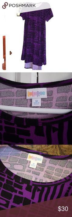 Beautiful Lularoe M Carly, like new Lularoe Carly in M, in a nice thick slinky polyester spandex blend (thicker than the T shirt material). Black background with a pretty purple geometric pattern. Shows no signs of wear, no holes, pulls, stains or pilling. Gorgeous dress! Color is most accurate in photos where it's laid out on my couch. Smoke-free and pet-free home. LuLaRoe Dresses Midi