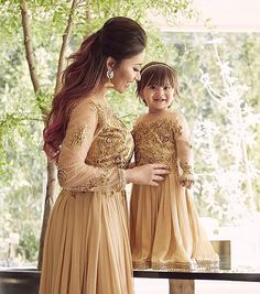 Image may contain: 2 people, people standing and outdoor Mom Daughter Matching Outfits, Mommy Daughter Dresses, Mom And Baby Dresses, Mother Daughter Fashion, Girls Dresses, Green Color Combination Dresses, Combo Dress, Pakistani Formal Dresses, Kids Gown