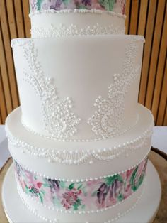 Hand painted cake inspired by the couple's watercolour stationary with hand piped royal icing lace inspired by the bride's wedding dress Painted Wedding Cake, Hand Painted Cakes, Hand Pipes, Royal Icing, Watercolour, Stationary, Wedding Cakes, Bride, Inspired