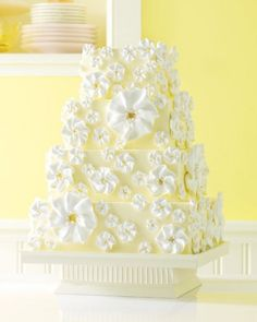 This riff on lemon pie is actually a white cake with buttercream frosting and alternating layers of lemon curd and buttercream filling inside. It's finished with delicate meringue flowers.