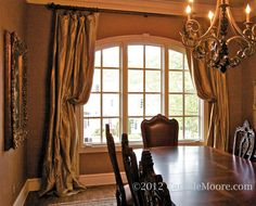 Silk Draperies Pulled Back On Arched Window In Dining Room Drapes