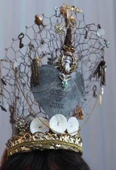 this is a crown made of chicken wire and odd things with a heart sign queen of junk
