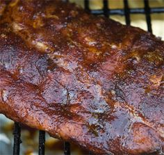 The recipe for making the best barbecue ribs you ever tasted. Just like the champion pitmasters do it. They are coated with a dry rub, then smoked low and slow for hours, and the sauce is added near the end and sizzled on.
