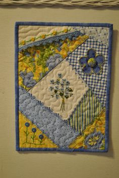 Crazy quilt with a vintage hanky in the middle by Brenda Kendrick <3