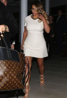 Kim Kardashian - Wearing A White Leather Dress and Triple Buckle Cut Out Sandals.