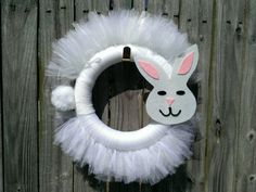 Isnt this the cutest little bunny wreath? Celebrate the arrival of the Easter bunny with this tulle and yarn wreath. The bunnys face is made