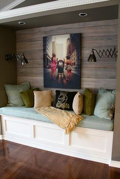 Love color scheme and wood backing on this bench.  Mix of white painted and dark stained wood is beautiful.