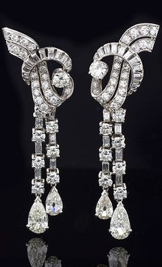 "French Art Deco ""Waterfall"" Diamond and Platinum Earrings A pair of French Art Deco platinum and diamond earrings. The long pendant earrings feature 64 round-cut diamonds with an approximate total weight of 6.00 carats and 36 baguette-cut diamonds with the approximate total weight of 2.00 carats. The earrings are finished with 4 pear cut diamonds with an approximate total weight of 3.80 carats (1.15 ct. and .75 ct on each earring) VS clarity and H-I color grade.The long drops are detachable."