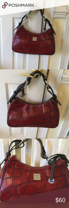 Dooney & Bourke bag Some wear not noticeable unless close to purse does'nt show as pictures good condition for price. Dooney & Bourke Bags Satchels