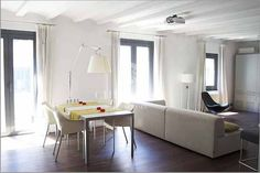 1 bedroom for rent Gothic quarter Barcelona has an area of 100 m2 with  one bathroom. This design loft has a modern kitchen and is equipped with a glass-ceramic hob plus an auxiliary kitchen with gas cooker, dishwasher, washing machine and dryer.