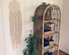 Feathers hang from a 12 inch brass ring. From top of ring to bottom tip of feather, this dreamcatcher hangs approximately 28 inches. Soul Design, Wicker Shelf, Decorating Ideas, Decor Ideas, Rv Campers, Awesome Bedrooms, Small Gifts, Rattan, Ladder Decor