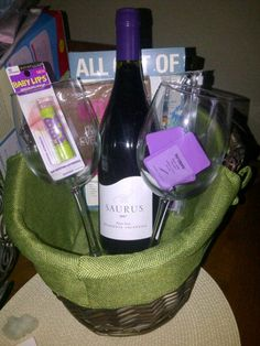 we are doing a diaper raffle this is the gift basket i have put together how amazing is it that i was able to find saurus wine with a picture of