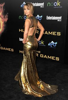 Jennifer Lawrence booty in a gold dress for Hunger Games premiere