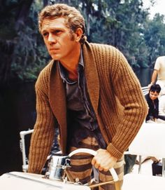 Steve McQueenpiloting a riverboat, while filming Nevada Smith, 1966.