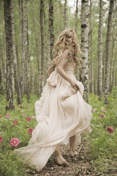 love the running away glance for a forest shoot in a long glamorous dress