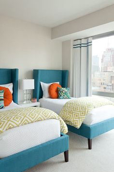 Clean and crisp...these upholstered beds with wing back headboards make for a smart modern design in a room from Bear Hill Interiors. --Love this color combo!