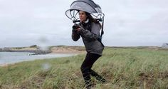 You might look like an idiot, but at least you're a dry idiot. The Nubrella is a wind-resistant, hands-free umbrella designed to make taking pictures easie