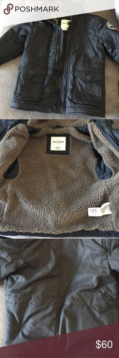 Abercrombie and Fitch winter coat Black coat with Sherpa inside. Hood had detachable fur. Has zipper and button closure. Warm and cozy . Looks great with all the pockets on the front. Only worn a few times! Excellent condition abercrombie kids Jackets & Coats Puffers