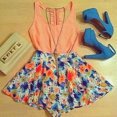 peach coral blush coloured tank top with floral pattern skirt, blue heels and gold necklace