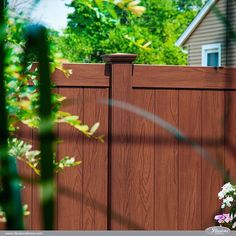 Amazing Rosewood PVC Vinyl Privacy Fence from Illusions Vinyl Fence. The Future of American Landscaping. #fence #backyardideas #homeideas (scheduled via http://www.tailwindapp.com?utm_source=pinterest&utm_medium=twpin&utm_content=post121055263&utm_campaign=scheduler_attribution)