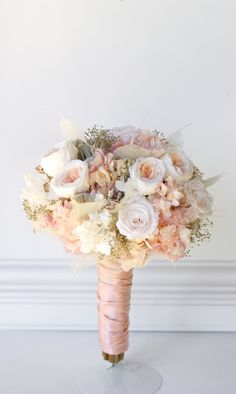 Rose Gold Bridal bouquet. All preserved real flowers to last for years. Cotton candy pink hydrangea, blush white roses, pink and cream garden roses, angel leaves, rose gold gems, gold babies breath, and touch of soft gray lambs ear. Display in a vase after to remind you of the wedding day for years after. See below for matching bridesmaids bouquets and boutonnieres PLEASE NOTE THAT THIS IS SOLD OUT UNTILL MORE STOCK ARRIVES AT END OF MAY BEGINNING OF JUNE. Note wedding date when ordering…