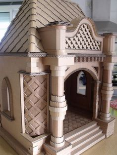 Is it a doll& house or a cat& castle or delightful dog den? Either way, it& made from cardboard. Cardboard Playhouse, Cardboard Castle, Cardboard Art, Cardboard Boxes, Cardboard Cat House, Cardboard Dollhouse, Cardboard Fireplace, Crafts With Cardboard, Cardboard Design