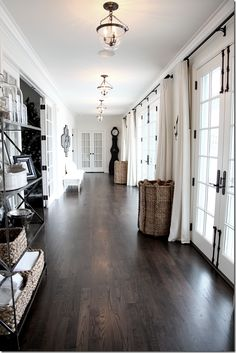 White + dark floor + french doors and those pendant lights....
