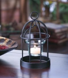 """by Gallery of Light The perfect perch for a candle! This charming iron birdcage candleholder features a glass candle cup, charming wire-frame design, and a hanging loop at top. Place a candle inside and light it to enjoy its cheery charm. 3.75"""" x 3.75"""" x 7""""  www.allgooddecor.com/shop.html #allgooddecor #decorations #gifts #candles #toys #discount #furniture #candleholders #home #figurines #lighting #pictures #mirrors #jewelry #garden #clearance #kitchen #bedandbath #wallart #kitchenware"""