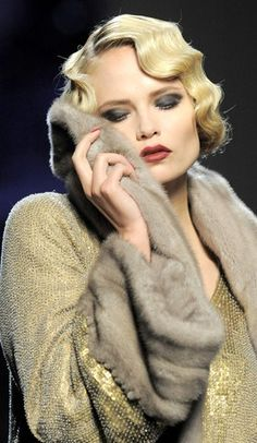 beautiful makeup and Art Deco hair, golden dress and soft fur, all colors match - full coziness in a perfect elegance.