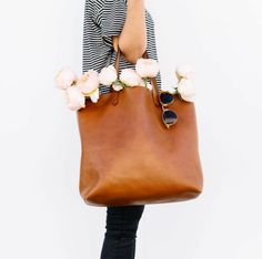 Love this brown leather tote bag.
