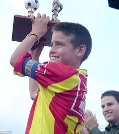 Up and coming: James Rodriguez as a 12-year-old lifting the trophy that set his career in motion...