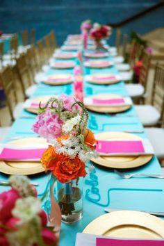 teal and fuchsia reception table decor