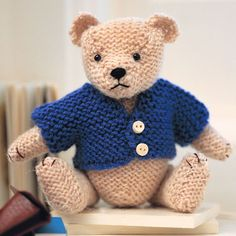 This super-cute soft toy in a jacket makes a great gift for children (or grown-ups), and it's easy to make with our free smart teddy bear knitting pattern.