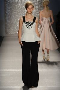 Top  - Ivory stretch faille bustier with black beaded scroll motif .  Bottom -  Black crepe wide leg pant