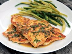 Thomas Keller's chicken breasts with tarragon butter sauce. This is a really good recipe - even if you don't like the seasoning, it's a great way to cook a moist chicken breast. Just switch out the seasonings if you want.