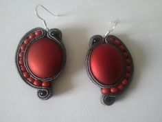 These earrings are a great match for one of the black and red brooches.  Gorgeous, very light handmade soutache earrings. Perfect for every occasion, especially for casual looks. They also look fantastic as an addition to formal, business outfits.  To embroider them I have used dark gray soutache, red acrylic bead, red and black glass beads.