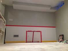Kids Playroom wall painted to look like hockey rink boards.