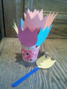 """Tulip craft - Read """"Flower Garden"""" by Eve Bunting then create a cup of paper flowers - colored craft sticks, tulip heads, paper coffee cups."""
